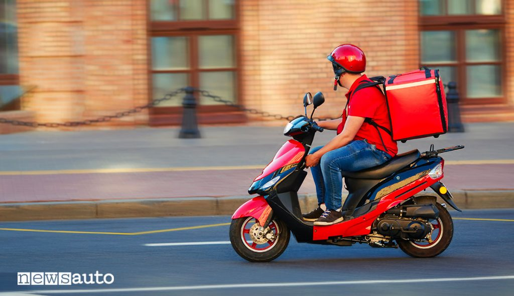 Rider food delivery in scooter
